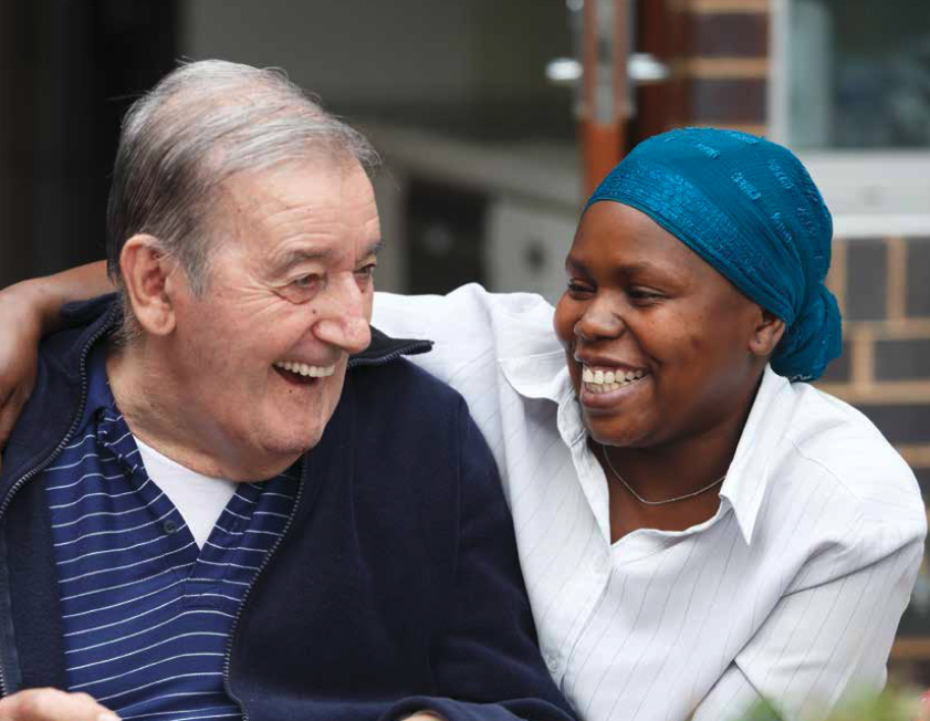 Young woman with elderly man laughing