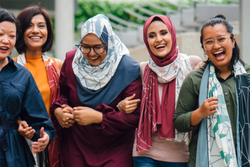 Group of women linking arms and smiling