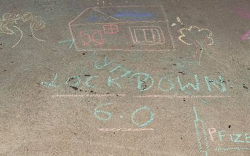 Chalk drawings of house on pavement